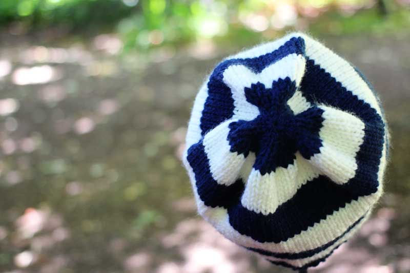 navy and white knit beanie